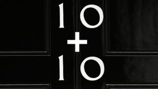 Two tens on a door generic