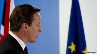 British Prime Minister David Cameron holds a press conference as part of a European Council on June 27, 2014, in Brussels