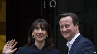 British Prime Minister David Cameron and his wife Samantha arrive at Number 10 Downing Street after election victory