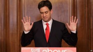 """Britain""""s Labour Party leader Ed Miliband holds up his hands as he delivers his resignation at a press conference in Westminster, London, 8 May 2015"""