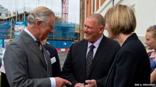 Prince of Wales meets residents of The Guinness Partnership's 250th affordable home in Poundbury
