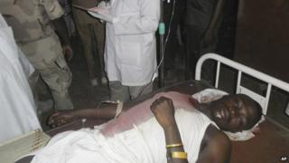 A student wounded during a suicide bomb attack at the College of Administrative and Business Studies receives treatment at a hospital in Potiskum Nigeria Friday, May 8