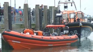 The RNLI Inshore lifeboat (front) damaged during the night