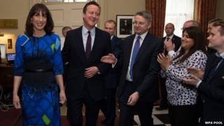 David Cameron is welcomed back to Downing Street by No 10 Cabinet Secretary Sir Jeremy Heywood and other staff