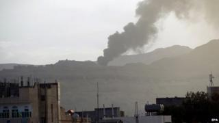 A black pall of smoke rises from an alleged weapons storage depot at a military camp of Houthi rebels following an airstrike of the Saudi-led alliance, in Sana'a, Yemen, 06 April 2015