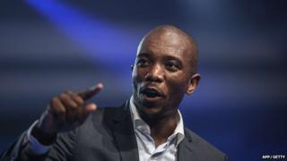 Mmusi Maimane, the newly elected leader of South Africa's main opposition party, gestures as he gives his maiden speech following his election in Port Elizabeth, South Africa, on 10 May 2015.