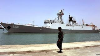 A Yemeni soldier keeps watch on the Chinese frigate, the Weifang, during an evacuation of Chinese people from Yemen in the western port city of Hodeidah, Yemen, on 30 March 2015