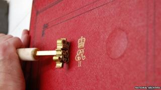 Royal cypher being embossed on the despatch box used by the Chancellor of the Exchequer