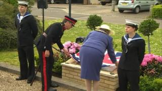The commemorative stone being unveiled