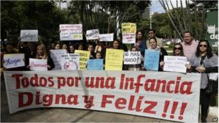People protest against child abuse, demanding stronger penalties for violators, in downtown Asuncion Paraguay (11 May 2015)