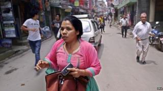 Nepalese search for open space as a strong earthquake hits Kathmandu, Nepal, 12 May 2015.