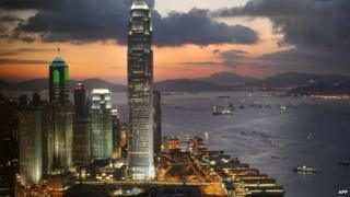The International Finance Centre towers over the southern Chinese city's Central district, illuminated during dusk in Hong Kong