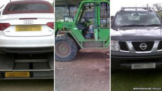 A sports car, digger and pick-up truck
