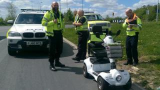 Police with the mobility scooter