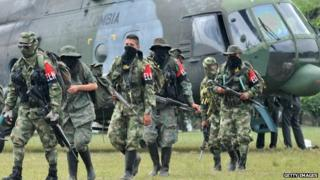 Demobilized members of the ELN (National Liberation Army) arrive in Cali, Colombia on July 16, 2013