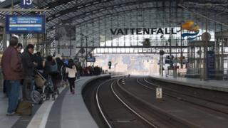 Passengers wait on the platform at the central station in Berlin, Germany
