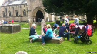 Picture of people picnicking on gravestones