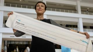 Cornelia Parker with a fragment of Magna Carta (An Embroidery) at the British Library