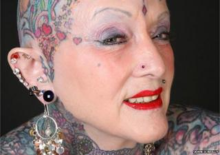 """Isobel Varley, 77, made it into the Guinness World Records and was called a """"legend"""" of the tattoo world"""
