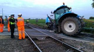 Tractor hit by train