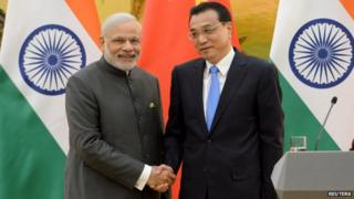 Mr Modi, left, and his Chinese counterpart Li Keqiang have pledged to improve bilateral ties between India and China