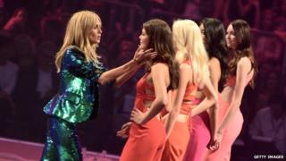 Heidi Klum interacts with the models during the Germany's Next Topmodel finals at SAP Arena on 14 May 2015 in Mannheim, Germany