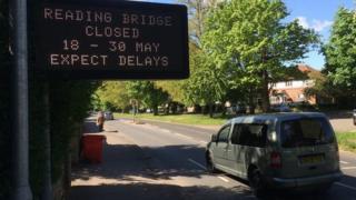 Reading bridge closure sign