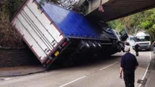 Lorry under bridge