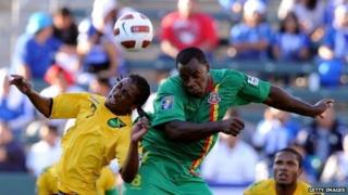 Delroy Facey (green) playing international football in 2011