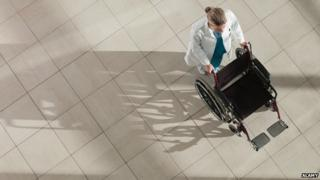 A doctor pushing a wheelchair
