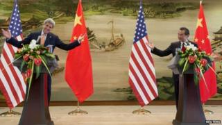 Chinese Foreign Minister Wang Yi and US Secretary of State John Kerry hold a joint news conference following meetings at the Ministry of Foreign Affairs in Beijing, China 16 May 2015