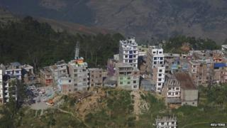 An aerial view of collapsed and damaged houses after the earthquake in the town of Charikot (14 May 2015)