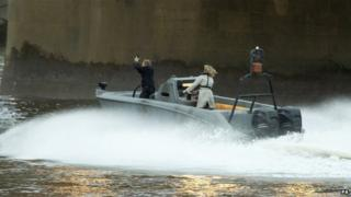 A Daniel Craig stunt double performs in a scene from the new James Bond film on the river Thames near Vauxhall,