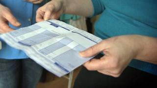 Worker looking at payslip