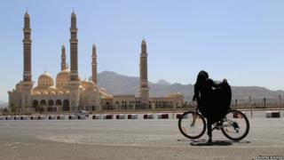Yemeni girl riding a bike in the capital Sanaa