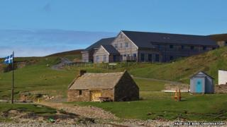 The Fair Isle bird observatory, pictured in the background, has recorded the migration patterns of birds.