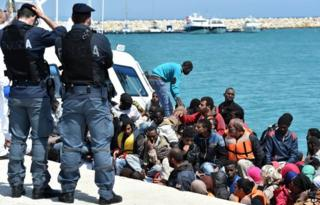 Migrants are helped ashore in Sicily (19 May)