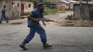 A policeman shouts as he holds his rifle during a clashes with demonstrators during a protest against Burundi President Pierre Nkurunziza and his bid for a third term in Bujumbura