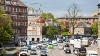 The street lamps hanging above a Copenhagen street