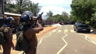 Police fire teargas to disperse demonstrators protesting against the murder of Vidya Sivayoganathan (May 2015)