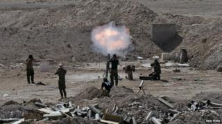 Members of the Iraqi army launch a mortar toward Islamic State militants on the outskirts of the city of Falluja, Iraq - 19 May 2015