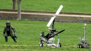 A bomb squad member inspects the gyrocopter after it landed at the US Capitol