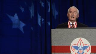 Robert Gates at a podium