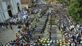 A mass funeral in Salgar 22 May 2015