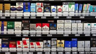 Cigarettes on shelves in a shop