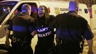 A protester is arrested after the acquittal of Michael Brelo, a patrolman charged in the shooting deaths of two unarmed suspects on 23 May 2015, in Cleveland