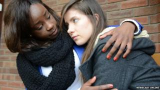 Young woman being comforted