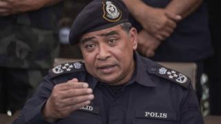 Malaysian national police chief Khalid Abu Bakar speaks during a press conference a day after the government announced the discovery of camps and graves, the first such sites found in Malaysia since a regional human-trafficking crisis erupted earlier this month, near Malaysia-Thailand borders in Wang Kelian on May 25, 2015.