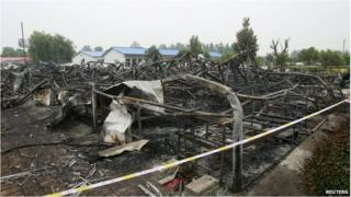 Remains of burned building in Pingdingshan, China (26 May 2015)