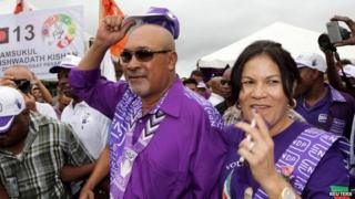 Suriname's President Desi Bouterse and his wife Ingrid after he cast his vote during parliamentary elections on 25 May, 2015